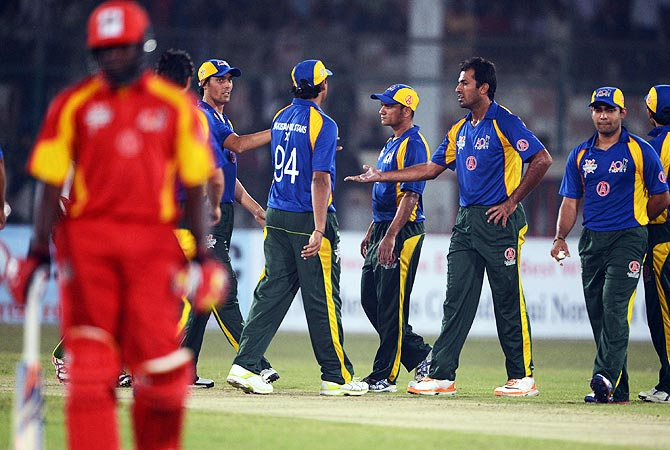 Pakistan All Stars players celebrates the dimissal of International World XI's Ricardo Powell (L). -Photo by AFP