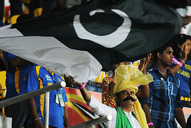 A man waves a Pakistan flag during the match. -Photo by AFP