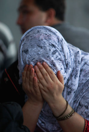 A detained ethinc Hazara woman covers her face at Pondok Dayung in Jakarta, October 25, 2012.