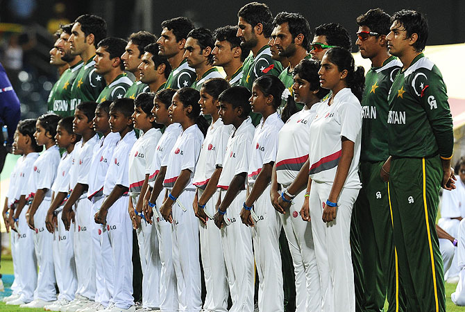 The Pakistan team line up and listen to their national anthem before the start of the match. -Photo by AFP