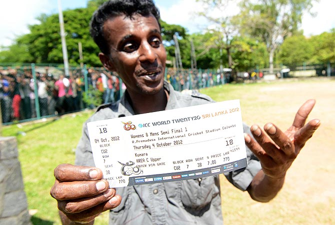 A fan holds out his ticket for the semi-final between Sri Lanka and Pakistan. -Photo by AFP