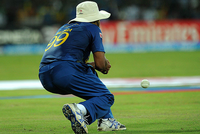 Lasith Malinga drops a catch. -Photo by AFP