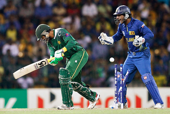 Pakistan's Shoaib Malik (L) is bowled out by Sri Lanka's Rangana Herath. -Photo by Reuters