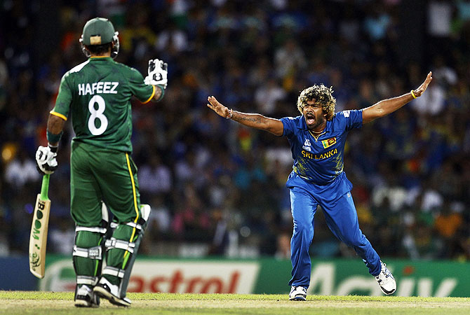 Sri Lanka's bowler Lasith Malinga, right, appeals unsuccessfully for the wicket of Pakistan's batsman Imran Nazir. -Photo by AP