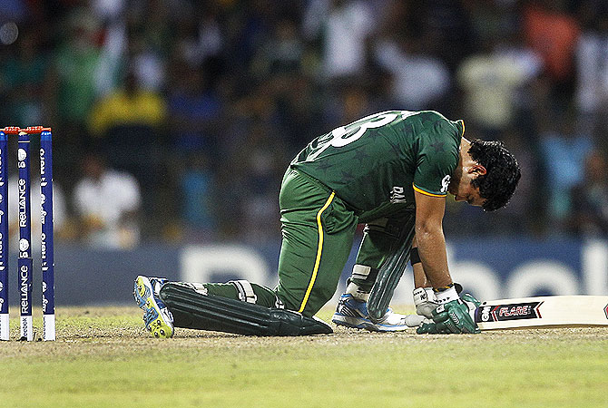 Umar Akmal reacts after he missed the chance to hit a boundary. -Photo by AP