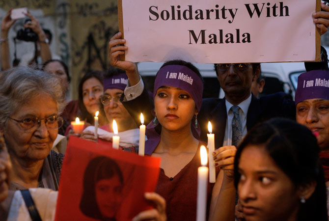 Pakistanis hold candles during a protest to condemn the attack on Malala Yousufzai.