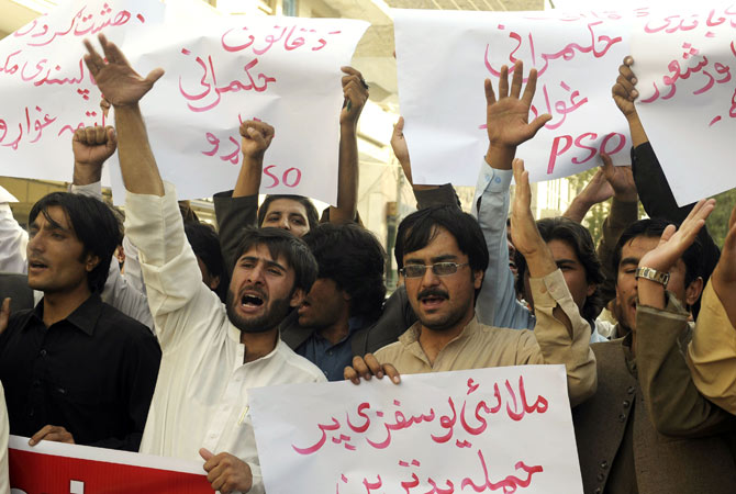 Pakistani students shout slogans during a protest against the assassination attempt on Malala Yousafzai, in Quetta on October 11, 2012.
