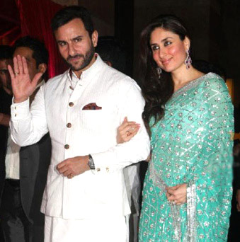 Saif Ali Khan and Kareena Kapoor at a wedding – File photo by AFP