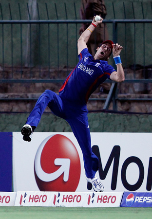 England's Steven Finn takes a catch to try and dismiss Sri Lanka's Angelo Mathews and goes over the boundary rope during their Twenty20 World Cup Super 8 cricket match in Pallekele October 1, 2012. Mathews was not out because Finn crossed the rope while holding onto the ball, instead adding 6 runs to Sri Lanka's total. - Photo by Reuters