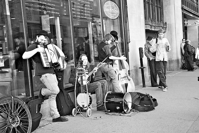 Buskers, street jugglers and mimes seem to appear from nowhere with the advent of summer. Here some musicians perform on the very popular St Catherine Street in downtown.