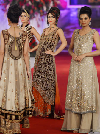 Models present creations by Pakistani designer Shazia on the last day of the Style 360 Bridal Couture Week fashion show in Lahore on October 15, 2012.