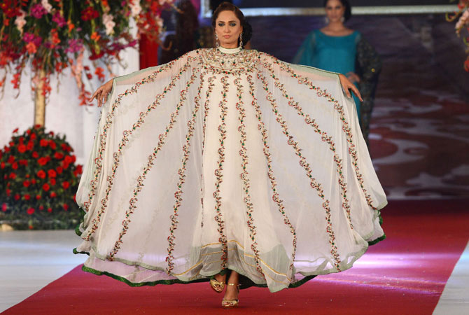 A model presents a creation by Pakistani designer Sadaf Arshad on the last day of the Style 360 Bridal Couture Week fashion show in Lahore on October 15, 2012.