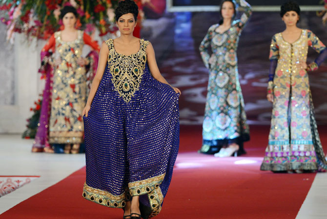 Models present creations by Pakistani designer Tabassum Mughal on the last day of the Style 360 Bridal Couture Week fashion show in Lahore on October 15, 2012.