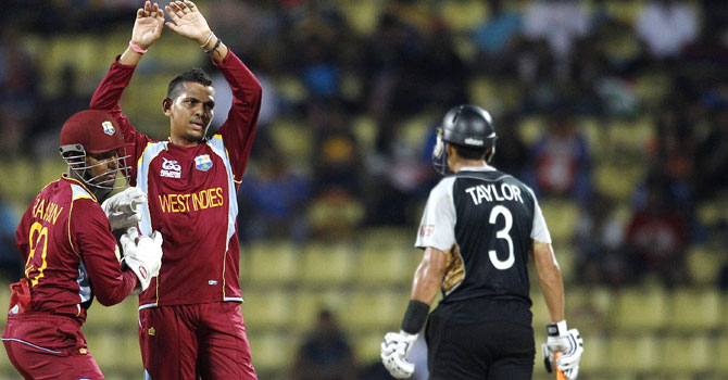 Sunil Narine celebrates after dismissing Jacob Oram. Narine was named man of the match – Photo by AP
