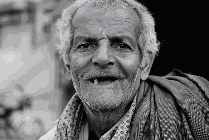 In a modern society obsessed with physical appearance, this man with a winsome smile seems perfectly contented with his one tooth! ? At Golra Shareef Shrine in Islamabad.