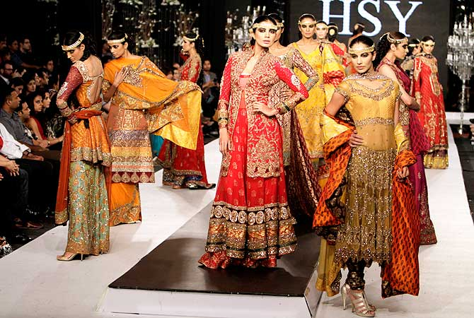 Models present creations by designer HSY, during a fashion show in Lahore. The show is organized by the Pakistan Fashion Design Council.-Photo by AFP