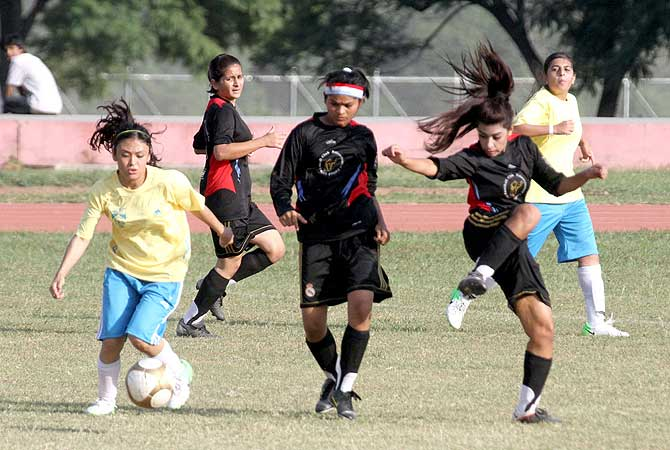 Players of Balochistan United and Young Rising Stars struggling during match of 8th National Women's Football Championship 2012 at Sports Complex. - Photo by APP