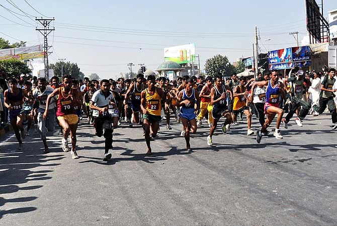 Athletes taking part in a race event during the Punjab Youth Festival in Faisalabad.- Photo by APP