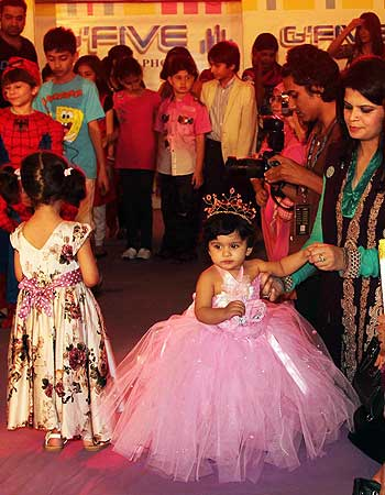 Children walk down the ramp during a fashion show in Lahore.- Photo by APP