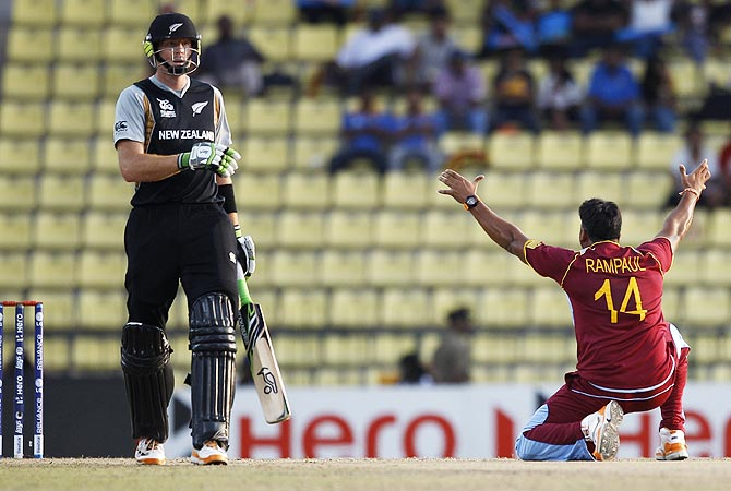New Zealand's batsman Martin Guptill, left, watches West Indies' bowler Ravi Rampaul, right, appeal successfully for the wicket of Rob Nicol. -Photo by AP