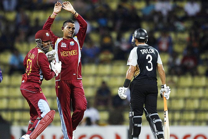 West Indies' bowler Sunil Narine, center, celebrates the dismissal of New Zealand's batsman James Franklin. -Photo by AP