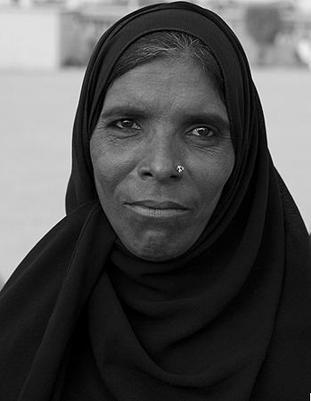 How could one not notice this face chiseled from black rock? Yet, many of us must have passed her by with nary a glance ? Beggar woman outside Abdullah Shah Ghazi shrine in Clifton, Karachi.