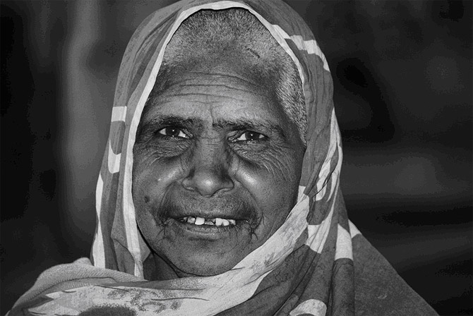I think it is not the lines on the palm but the lines on the face that tell a person's fortune. Learn to read between the lines and there is a novel in every old face  - A beggar woman at Golra Shareef shrine in Islamabad.