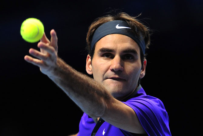 Switzerland's Roger Federer serves during the singles final against Serbia's Novak Djokovic on the eighth day of the ATP World Tour Finals tennis tournament in London.