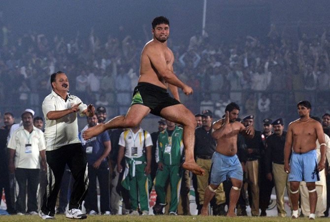 A Pakistani kabbadi player reacts during the Kabaddi Asia Cup final match against India in Lahore late on November 5, 2012.