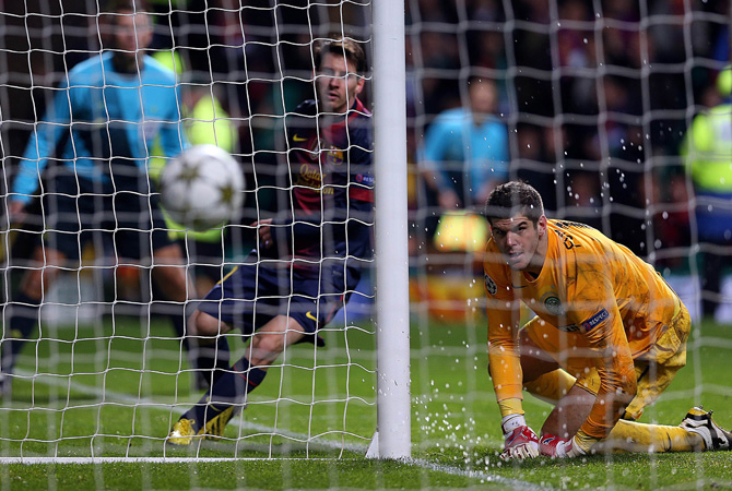 Barcelona's Argentinan striker Lionel Messi scores during their UEFA Champions League Group G football match at Celtic Park in Glasgow on November 7, 2012. Celtic won 2-1.