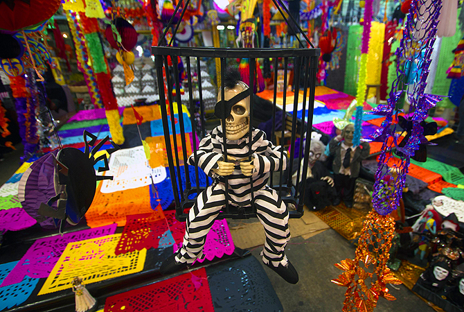 A skeleton figure is displayed at the Jamaica market in Mexico City to celebrate the Day of the Dead. The rituals that celebrate deaths of ancestors for this holiday date back to almost  2500 years.