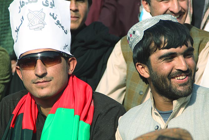 Kandahar supporters. The football ground was full of spectators and to my surprise they came prepared with flags, placards and smiles.