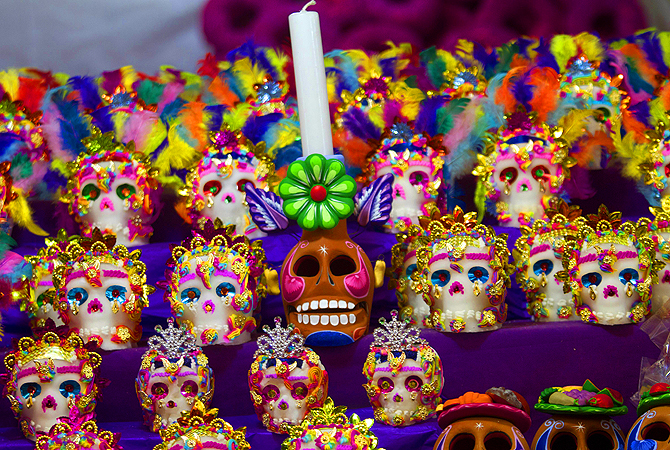 "Mexican traditional sugar ""Calaveritas"" (Little Skulls) are displayed at the Jamaica market in Mexico City, as Mexicans prepare to celebrate the traditional Day of the Dead."