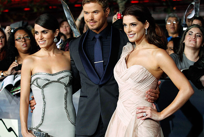 "Cast member Kellan Lutz poses with co-stars Ashley Greene (R) and Nikki Reed at the premiere of ""The Twilight Saga: Breaking Dawn - Part 2"" ? Reuters Photo"