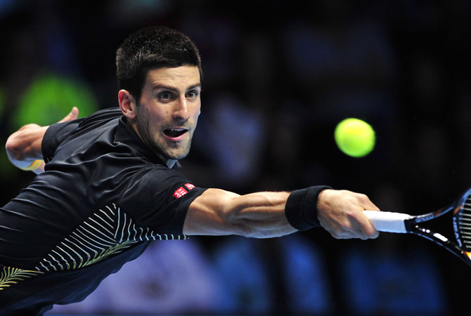 Djokovic returns during the singles final against Federer on the eighth day of the ATP World Tour Finals tennis.