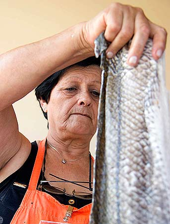 Esther Nunez of Argentina, treats fish skin to make a type of leather to be used in fashion. ? Reuters Photo
