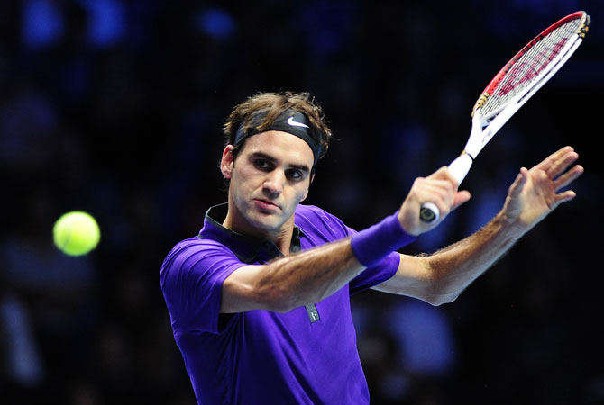 Federer returns against Serbia's Novak Djokovic on the eighth day of the ATP World Tour Finals tennis tournament in London.