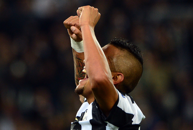 Juventus' midfielder of Chile Arturo Vidal celebrates after scoring during the Champions League match between Juventus and FC Nordsjaelland on November 7, 2012 in the stadium of Alps in Turin.