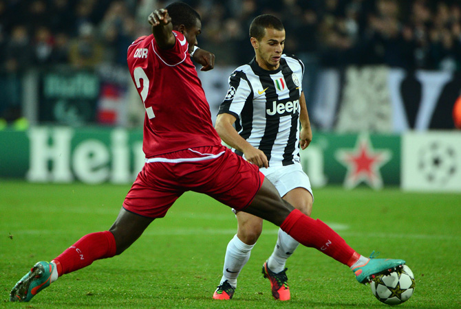 Juventus' forward Sebastian Giovinco (Right) fights for the ball with Nordsjaelland's defender Jores Okore during the Champions League match between Juventus and FC Nordsjaelland on November 7, 2012 in the stadium of Alps in Turin.