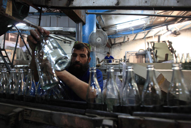 A worker at Pakistan's lone beer maker, Murree Brewery, checks the quality of bottles at the factory in Rawalpindi.