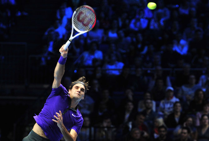 Federer serves against Serbia's Novak Djokovic during the singles final on the eighth day of the ATP World Tour Finals tennis tournament.