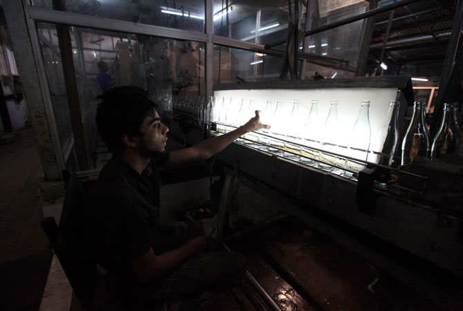 A worker at Pakistan's lone beer maker, Murree Brewery, lines up empty beer bottles at the factory in Rawalpindi.