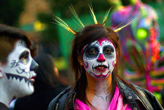 Mexican students at UNAM in Mexico City, during preparations on the eve of the Day of the Dead celebrations. The symbol most represented during the holiday in the form of masks and face paint, is the skull or calacas in colloquial terms.