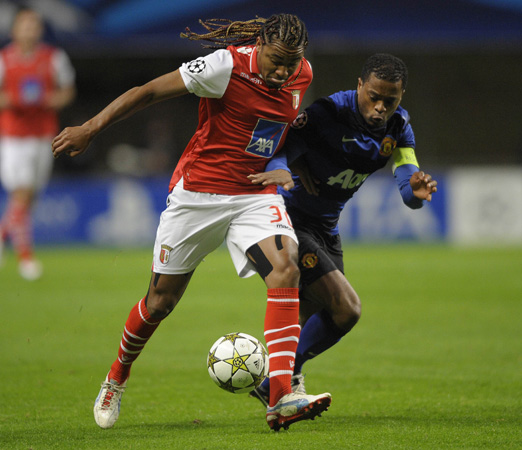 Braga's Brazilian forward Alan Silva (Left) vies with Manchester United's French defender Patrice Evra during the UEFA Champions League football match SC Braga vs Manchester United at the Municipal stadium of Braga.
