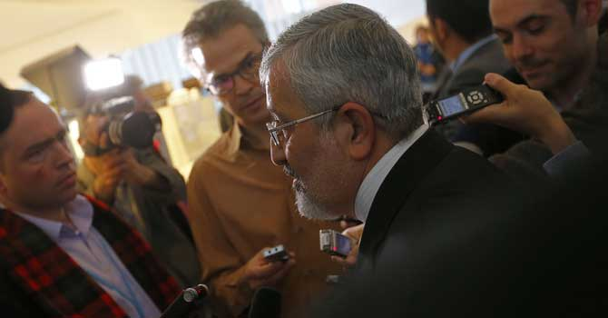 Iran's envoy to the IAEA Ali Asghar Soltanieh answers to journalists on the sidelines of the IAEA Board of Governors meeting at the UN atomic agency headquarters in Vienna on November 30, 2012. – Photo by AFP