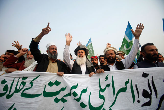 Supporters of Pakistan's religious political party Jamaat-e-Islami shout anti-US and anti-Israel slogans during an anti-Israel demonstration in Peshawar November 23, 2012. Israeli gunfire at the Gaza border killed one Palestinian on Friday and wounded several others, medics said, two days after a ceasefire between the territory's rulers Hamas and Israel took hold. The banner reads in Urdu: ?Against Israeli barbarity?.
