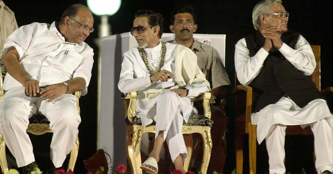 Hindu hardline Shiv Sena party leader Bal Thackeray, center, talks to Indian Agriculture Minister Sharad Pawar, left, at the release ceremony of a pictorial biography on his life, as former Indian Prime Minister Atal Behari Vajpayee looks on in Mumbai, India. Thackeray, the extremist leader linked to waves of mob violence against Muslims and migrant workers, has died Saturday, Nov. 17, 2012, after ailing for several weeks. He was 86. - File photo by AP