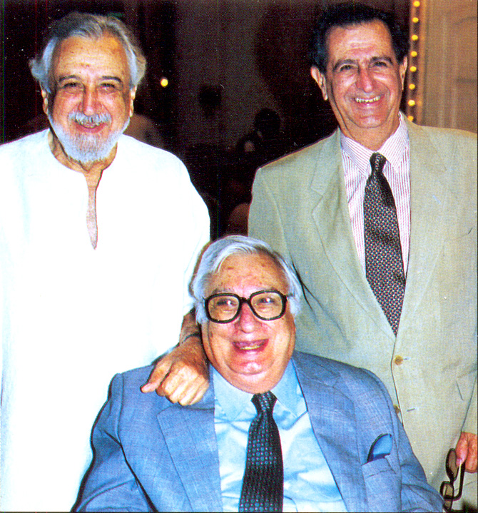 Ardeshir (standing L), Cyrus (R) and John (sitting). – Photo courtesy Sama Books