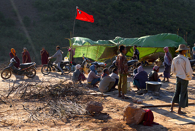 Hundreds of Buddhist monks and villagers occupying the mine, they said is causing environmental, social and health problems, defied a government order to leave by Wednesday, saying they will stay until the project is halted.?Photo by AP