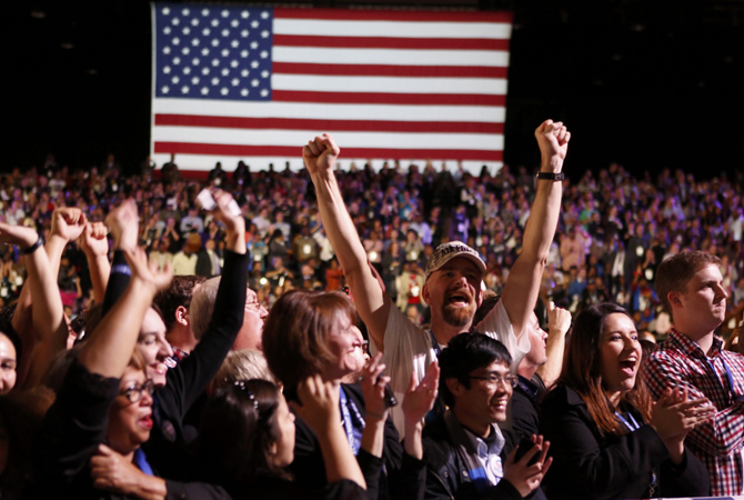 Supporters of U.S. President Barack Obama cheer during his election night rally in Chicago, November 6, 2012.—Photo by Reuters